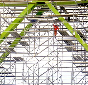 In this April 2017 file photo, a worker navigates scaffolding underneath the Astoria Bridge.