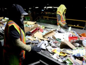 Recycling sorters pull non-recyclables off a conveyor belt at Garten Services in Salem on Thursday, Jan. 11, 2018.
