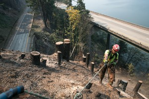 Fire fighters near the Tooth Rock tunnel try make sure slopes are stable.