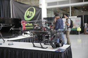 Exhibitors speak with attendees at the Oregon Precision Farming Expo