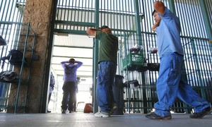 In this Thursday, Aug. 9, 2012, file photo, suspected illegal immigrants are transferred out of the holding area after being processed at the Tucson Sector of the U.S. Customs and Border Protection headquarters in Tucson, Ariz.
