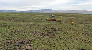 In this 2015 file photo, provided by the Bureau of Land Management, a rangeland drill reseeds an area burned by the Soda Fire in southwest Idaho.