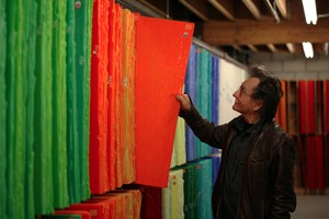 Bullseye Glass co-founder Dan Schwoerer pulls out one of the orange glass sheets his company makes using cadmium.