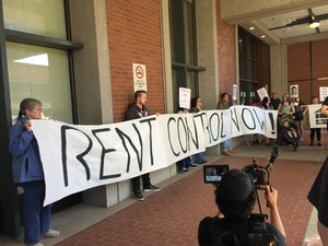 Rent control advocates rally outside the Multnomah County administration building on April 7, 2016.