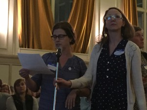 Jessica Applegate and Amanda Jarman deliver their demands for more stringent air pollution controls to public officials at an open house Tuesday in Portland.
