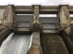 Water spills through a spill bay in The Dalles Dam to help improve fish passage.