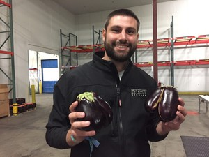 Imperfect Produce CEO Ben Simon shows off two 'ugly' eggplants in his new company warehouse in Clackamas.