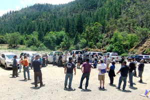 Fish biologists and technicians gather on the Salmon River in California for a Fish Kill Response training.