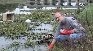 In 2002, the Basel Action Network's Jim Puckett tests the water quality near Guiyu, China, where residents cooked electronics to extract precious metals and dumped the leftovers in a nearby river.