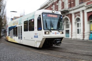 TriMet's MAX line passes through downtown Portland near the Skidmore Fountain.