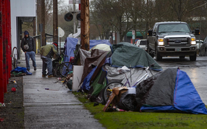 A makeshift camping site has formed in recent weeks along Lawrence Street in Eugene near the railroad tracks.