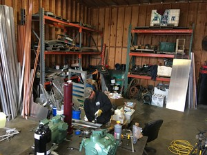 Clint Funderburg builds a refrigeration system in his shop while he waits for better fishing markets.