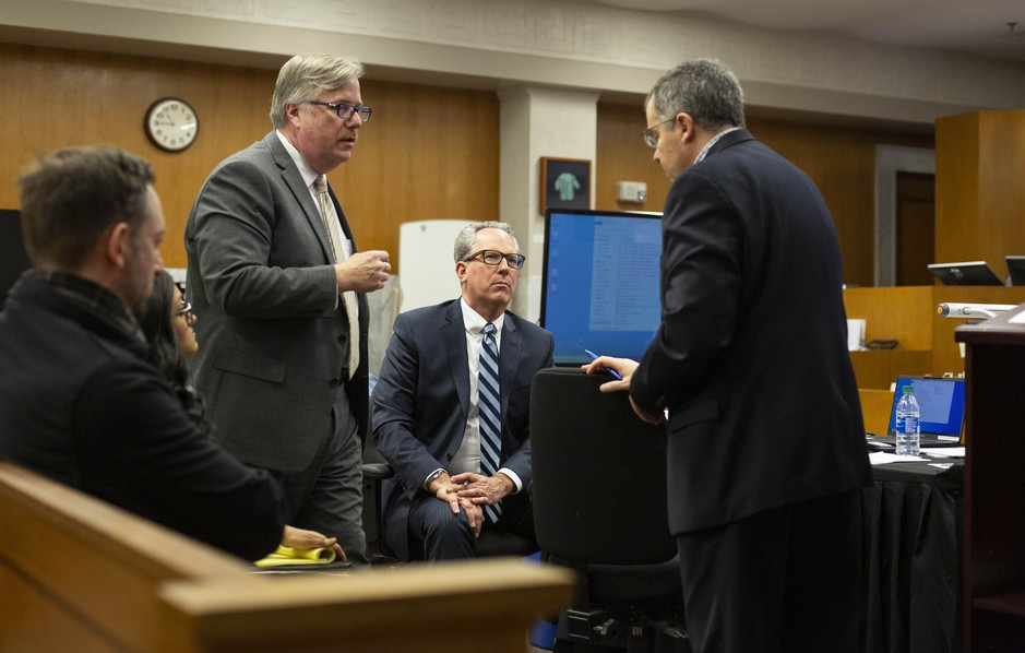 Defense attorney Greg Scholl (left) and prosecutors Don Rees and Jeff Howes discuss legal matters before a recess at the Multnomah County Courthouse on Feb. 13, 2020, day 11 in the trial of Jeremy Christian for the stabbing of three people on a MAX train in Portland in May 2017.