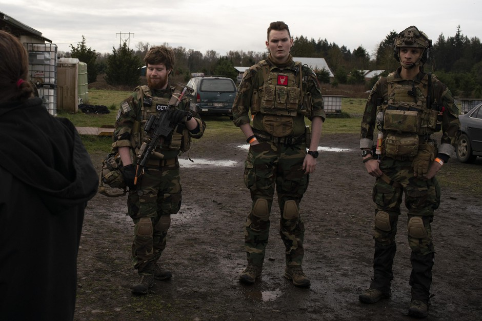 Noah Wenger, Andrew Pollmann, and Alex Bates listen to the rules before playing an AirSoft game at Action Acres AirSoft on March 23, 2019, in Canby, Ore.