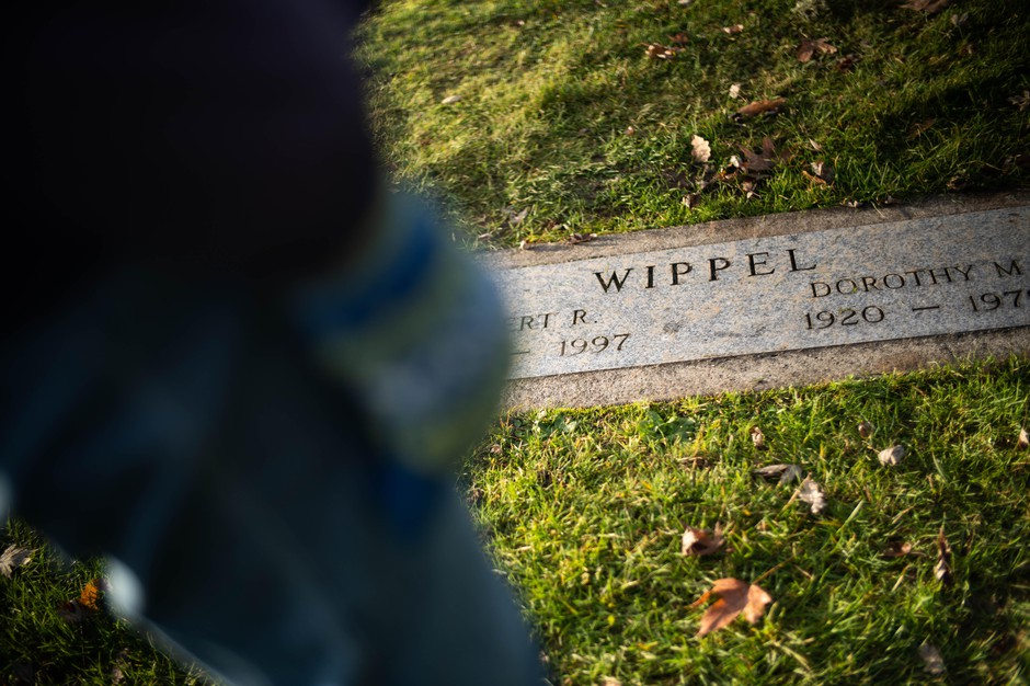 Carroll and Roberta Gorg visit James Wippel's unmarked grave site next to his parents' at Riverview Cemetery on December 10, 2019.