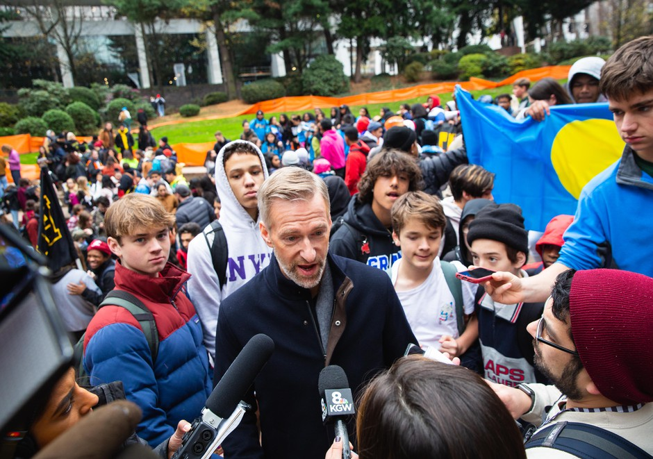 Mayor Ted Wheeler received the demands of the student activists after they marched to Terry Shrunk Plaza across from City Hall.