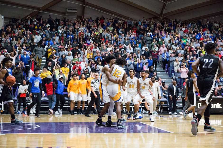 Jefferson High School fans celebrate following a big basket during OSAA boys basketball championships in Portland, Ore., March 10, 2018.