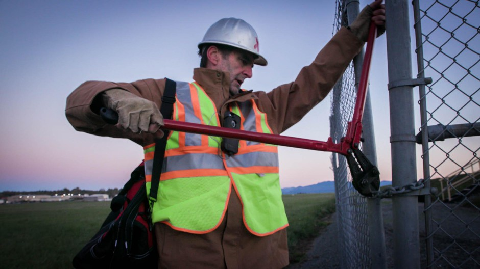 """Activist Ken Ward illegally cuts a fence to shut down a pipeline. Ward is featured in the new documentary, """"The Reluctant Radical."""""""