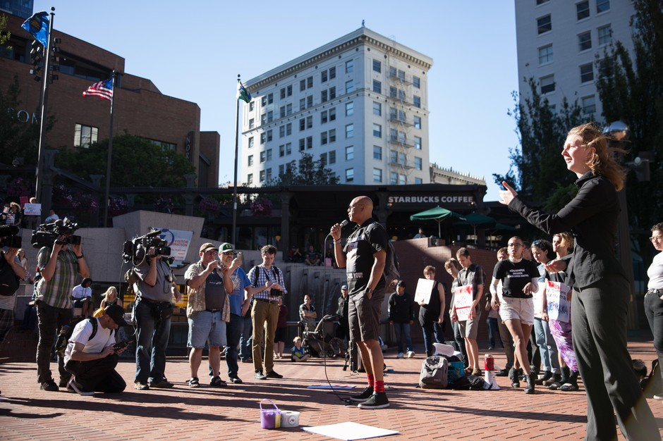 Andre Washington speaks about his brother at a rally in Portland Sunday, July 1, 2018.
