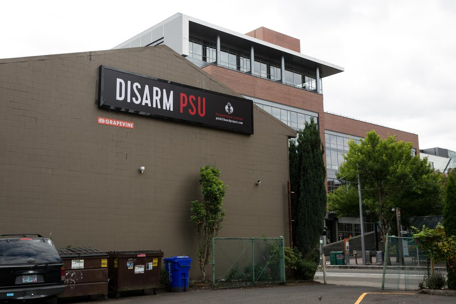A billboard placed in downtown Portland calls for the disarmament of Portland State University police officers.