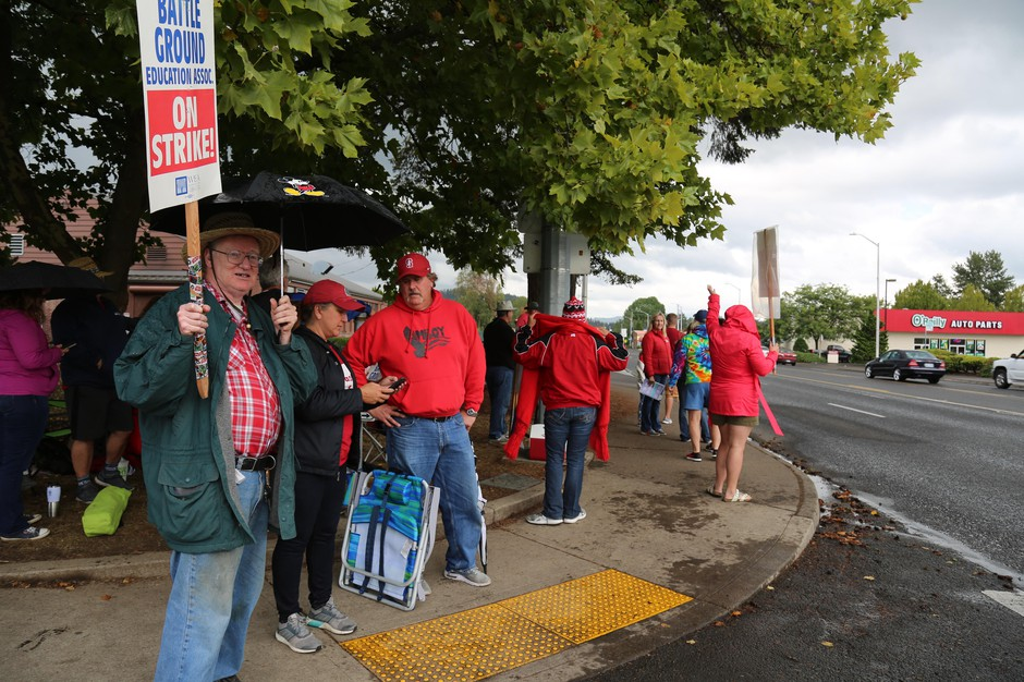 Striking Battle Ground teachers wave picket signs outside Battle Ground High School. The teachers have been on strike since Aug. 29.