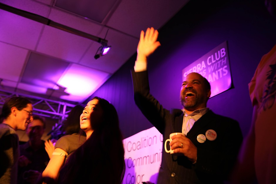 Supporters of Measure 26-201 celebrate their Election Night victory in Portland, Oregon, Tuesday, Nov. 6, 2018.