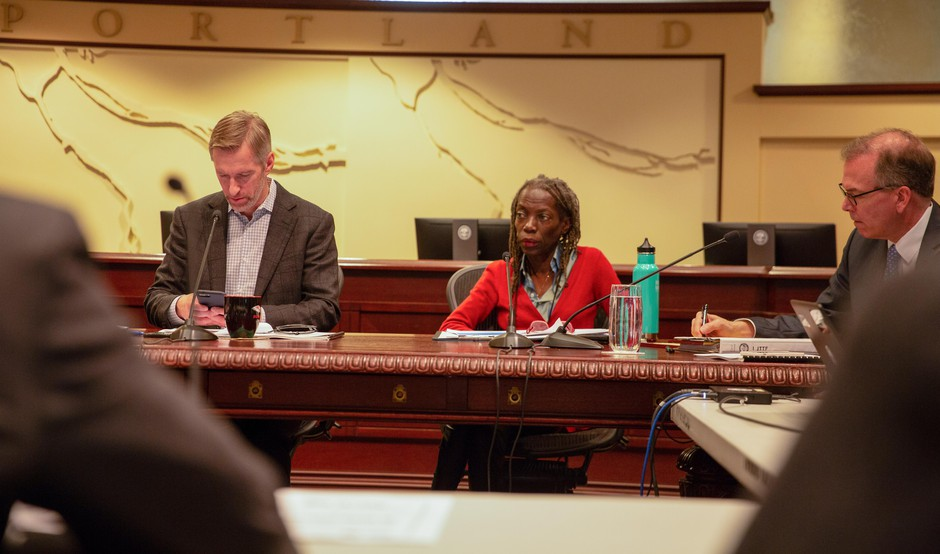 Portland Mayor Ted Wheeler and Commissioner Jo Ann Hardesty listen during a work session discussing Portland's involvement in the Joint Terrorism Task Force at City Hall Tuesday, Feb. 12, 2019, in Portland, Ore. Hardesty has proposed withdrawing Portland from the JTTF, while Wheeler opposes it.