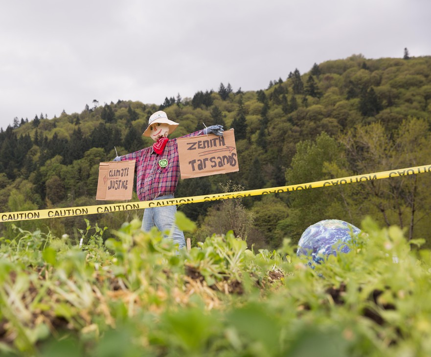 A scarecrow watches over a protest garden near the tracks leading to Zenith Energy's oil-by-rail terminal in Portland, Oregon, on Sunday, April 21, 2019.