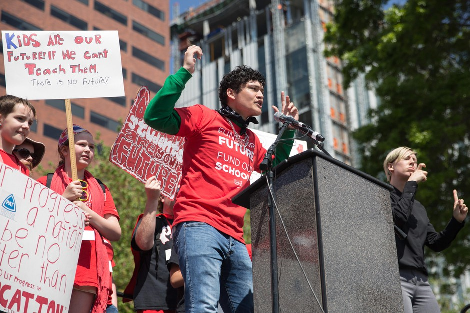 A Portland high school student who goes by the name Jolly Wrapper addresses a rally of teachers and their supporters in Portland, Ore., on May 8, 2019.The crowd gathered to advocate for more school funding.