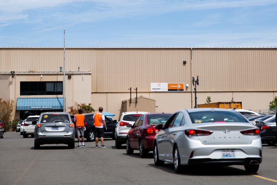 Vehicles queue at the Amazon delivery station in northwest Portland, Ore., Friday, July 12, 2019.