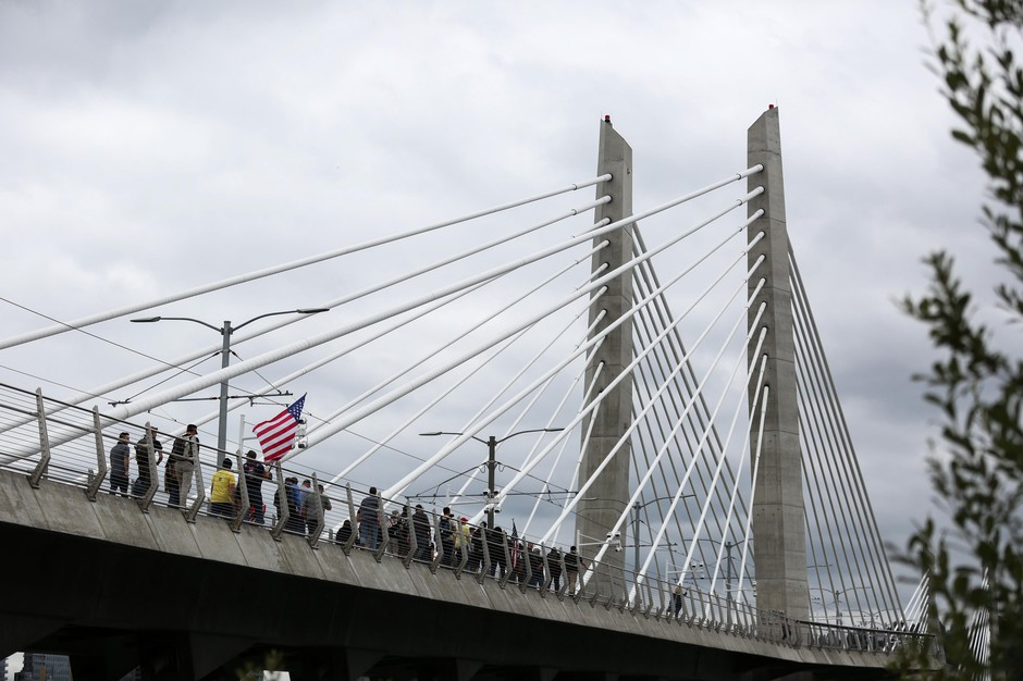 Members of the Proud Boys march across the TilikumCrossing in downtown Portland, Ore., Saturday, Aug. 17, 2019. The Proud Boys, designated a hate group by the Southern Poverty Law Center, had organized a rally against antifascists.
