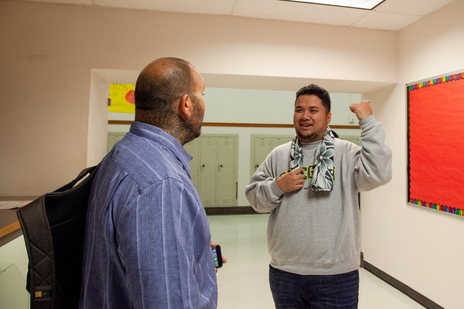 Ken Ramirez greets Dale, a senior, at North Salem High School in Salem, Ore., Tuesday, Sept. 17, 2019. Community resource specialists like Ramirez help student groups achieve academic success with one-on-one support.