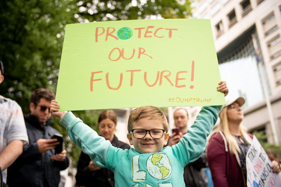 Nathan Porter holds his handmade sign at the Portland climate strike.