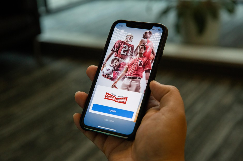 OPB reporter Donald Orr uses the Oregon Lottery Scoreboard sports betting app in Portland, Ore., on Friday, Feb. 7, 2020. The Oregon Lottery launched the online sports betting platform in late 2019, which allows users to place bets on professional sports ranging from football to darts.