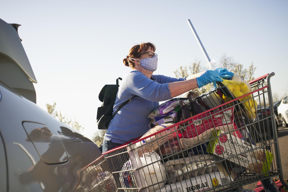 A Costco customer loads groceries into her car in Tigard, Oregon, March 20, 2020.
