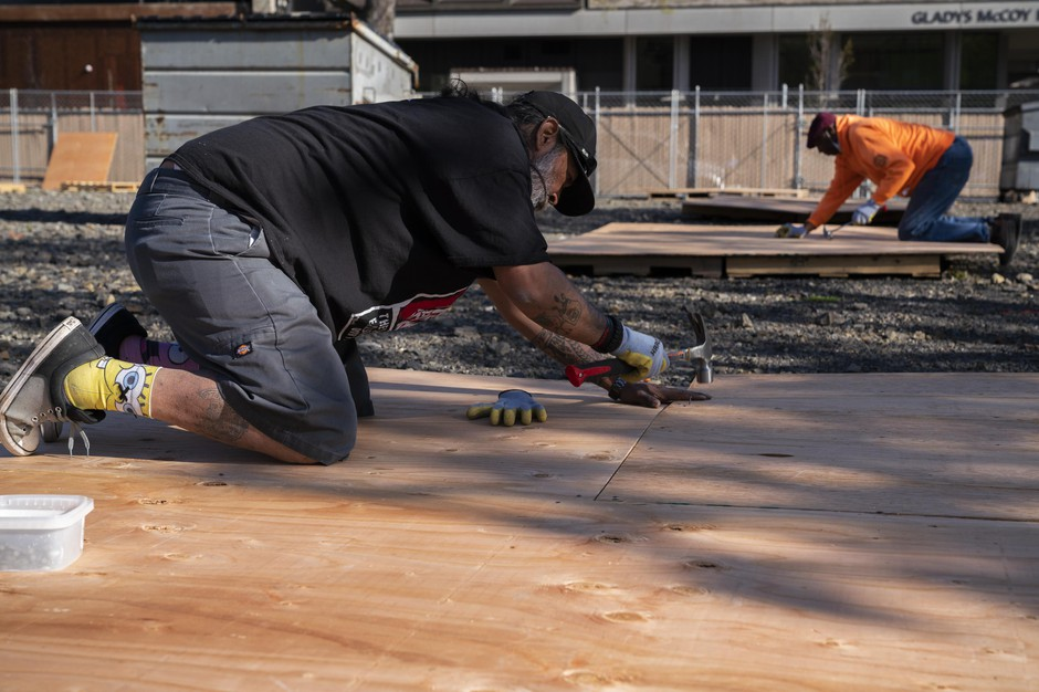 Art Rios and Charles Johnson build tent platforms for an emergency outdoor shelter for unhoused people of color on April 10, 2020 in Portland, Oregon. The shelters are necessary to help the most vulnerable unhoused people safely shelter-in-place during the coronavirus pandemic.