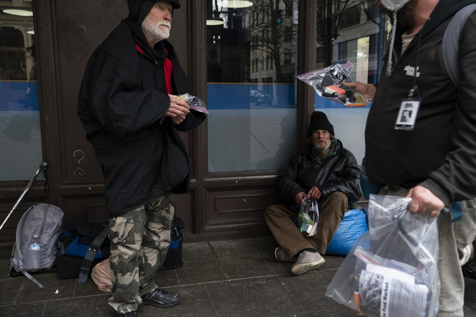 Mike Dusek, an unhoused person living in Portland, distributes hygiene supplies to other members of the unhoused community on March 28, 2020 in Portland, Oregon.
