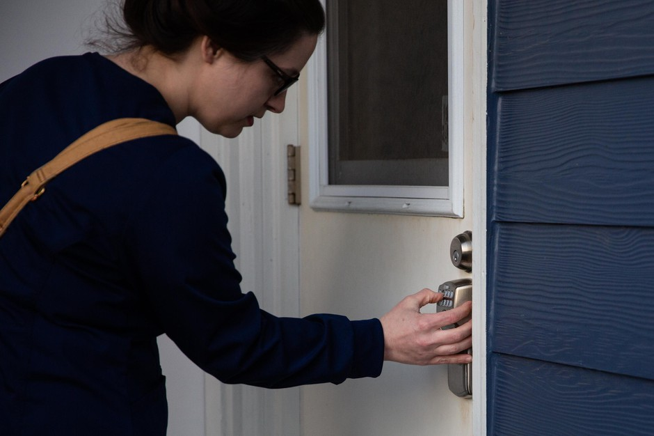 Sarah Collins keys into her Airbnb in Portland, Ore., after her shift Tuesday, April 7, 2020. Collins, an intensive care unit nurse at PeaceHealth Southwest, chose to live in an Airbnb during the COVID-19 pandemic to isolate from her family.