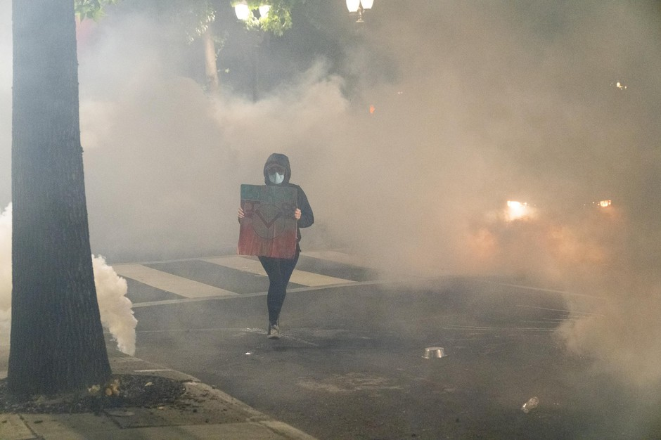Portland's Friday nightprotests ended with police using tear gas, flash bangs and rubber bullets to disperse the crowd, after protesters threw water bottles and fruit at police and then knocked down a fence.
