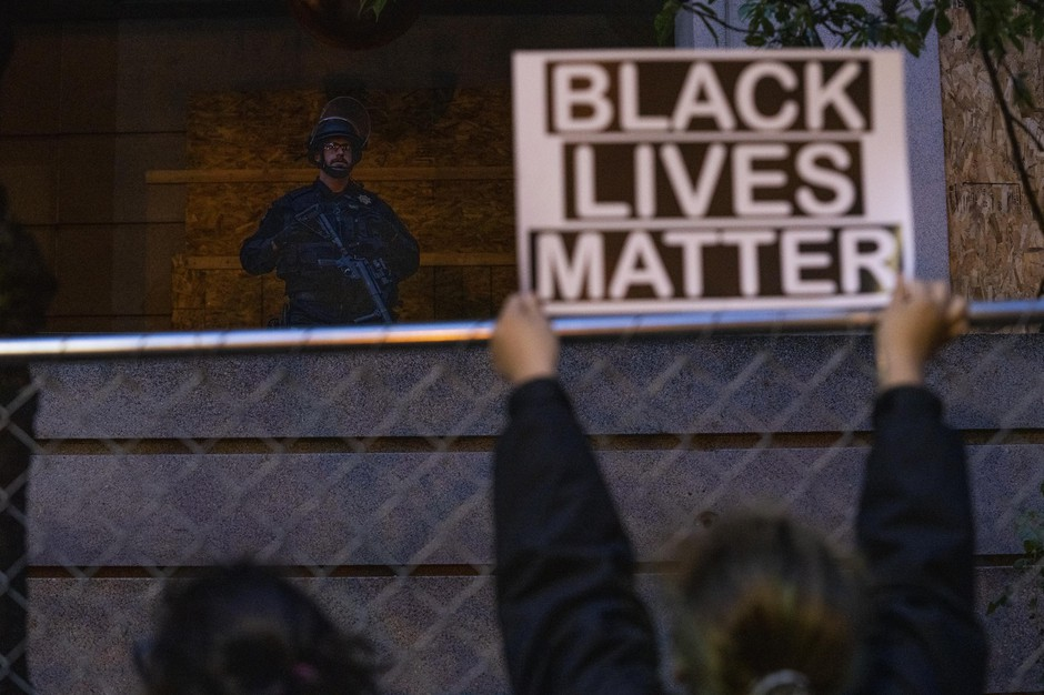 Hundreds of protesters gathered at the Multnomah County Justice Center in the third week of widespread demonstrations against structural racism and police violence on June 15, 2020. Throughout the night protesters shined flashlights and laser pointers at police officers and sheriffs deputies, who ultimately used physical force and less lethal munitions to disperse the crowd.