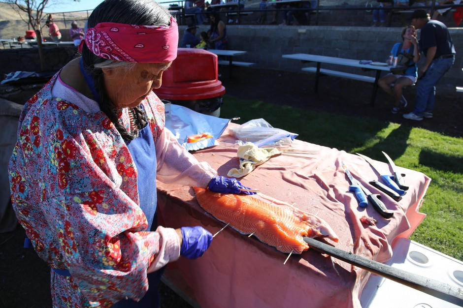 Roma David prepares salmon for the last weekend of operation at Kah-Nee-Ta resort.