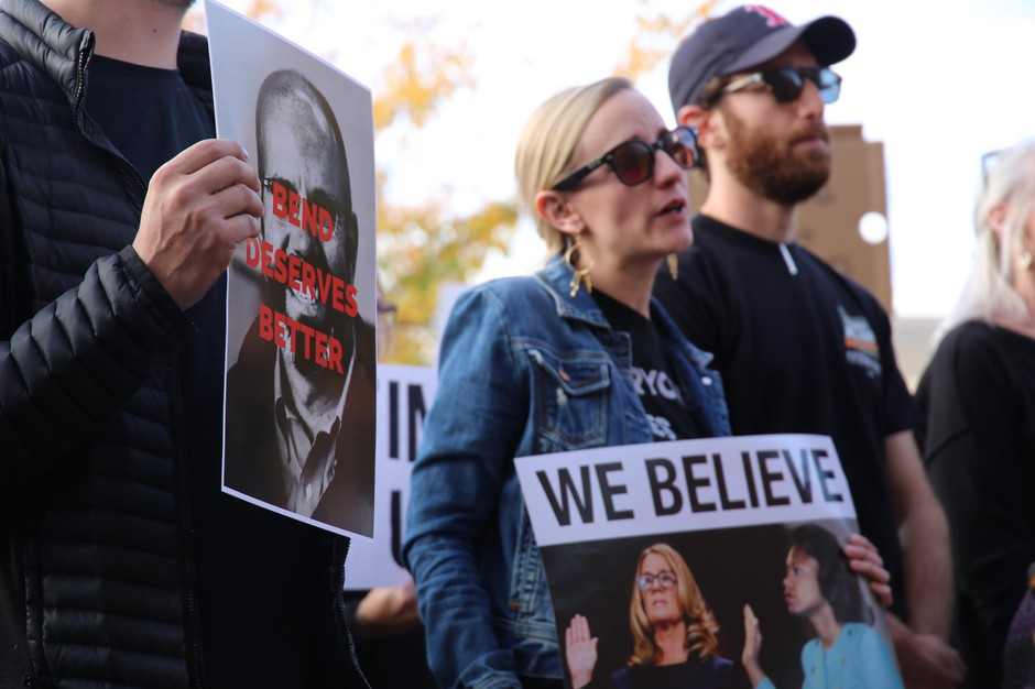 """Protestors outside Bend City Hall on Oct. 3 carried pictures of Nathan Boddie's face with the text """"Bend Deserves Better."""""""