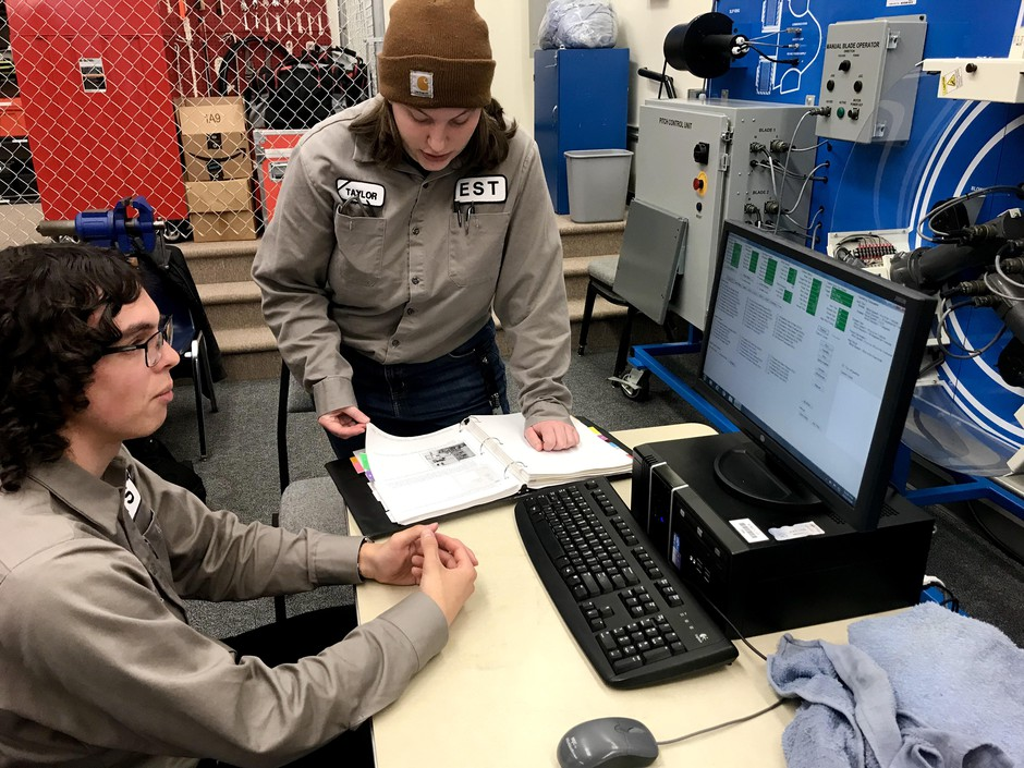 Evan Taylor, left, and Taylor Hays are studying at Walla Walla Community College to work in the renewable energy field. In this class, they're purposefully causing problems with wind turbine equipment so that they can learn how to fix it.
