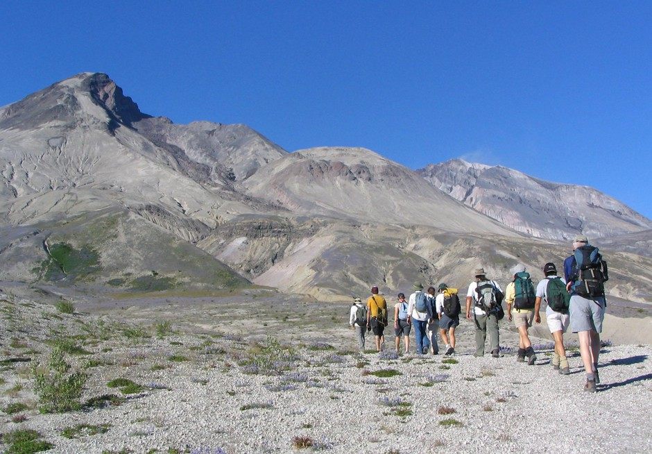 Researchers and students hike across the pumice plain north of Mount St. Helens toward the crater on Friday, July 23, 2004, in Windy Ridge, Wash. Scientists from around the world have come to the volcano to study its plants and geology since its May 18, 1980 eruption.