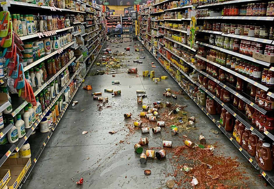 Food that fell from the shelves litters the floor of an aisle at a Walmart following an earthquake in Yucca Yalley, Calif., on Friday, July 5, 2019.