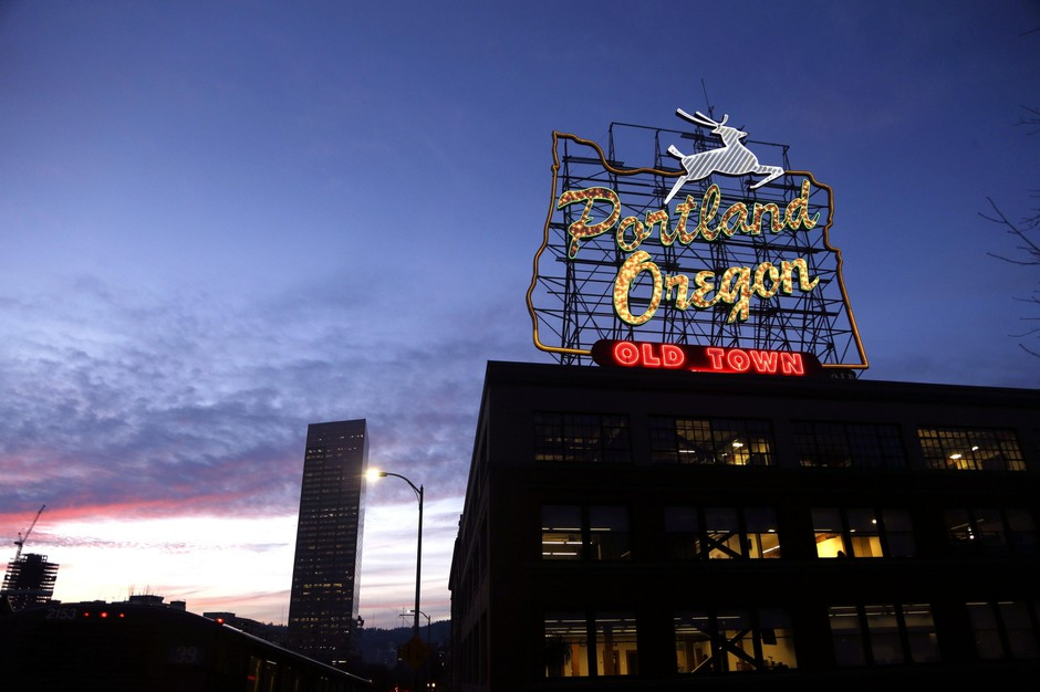"""This Jan. 27, 2015, file photo, shows the """"Portland, Oregon"""" sign in downtown Portland, Ore."""
