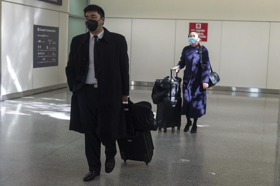 Air China cabin crew wearing face masks walk out of the international terminal at the San Francisco International Airport in Millbrae, California, United States on January 31, 2020.