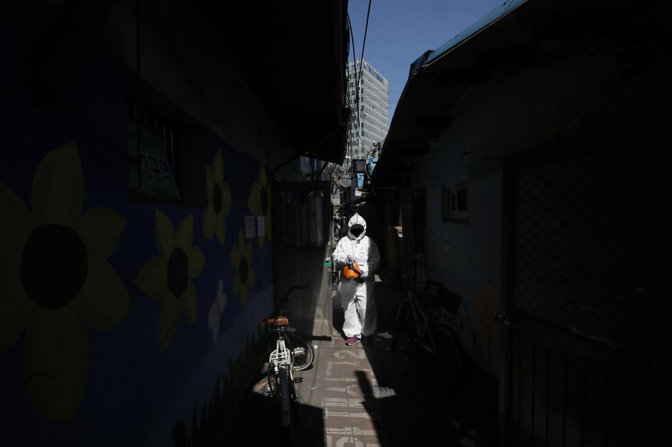 A worker wearing a protective gear disinfects as a precaution against the new coronavirus in Seoul, South Korea, Monday, March 16, 2020. For most people, the new coronavirus causes only mild or moderate symptoms, such as fever and cough. For some, especially older adults and people with existing health problems, it can cause more severe illness, including pneumonia.
