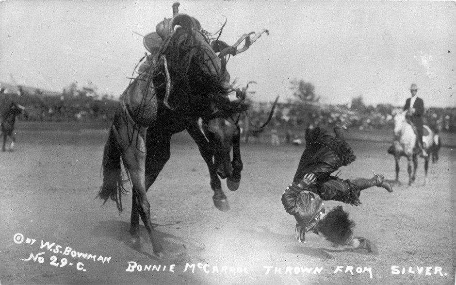 Cowgirl Bonnie McCarroll is thrown from a horse named Silver during a bucking contest at Pendleton Round-Up. After the Round-Up started in 1910, cowgirls were stars until McCarroll was killed in a bronc-riding accident in 1929. Photographer: Walter S. Bowman, September 1915.