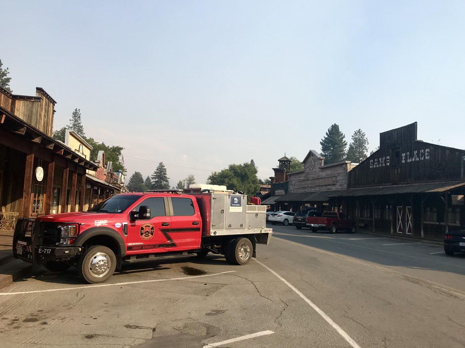 A fire truck parks in downtown Winthrop, Washington. The Methow Valley sees signs of fire nearly every summer, including vehicles filled with firefighters rattling down the highway or parked in town.